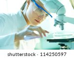 serious female chemist working... | Shutterstock . vector #114250597