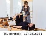 brunette female instructor with ... | Shutterstock . vector #1142516381