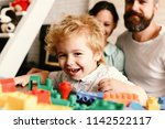 parents and son with happy... | Shutterstock . vector #1142522117