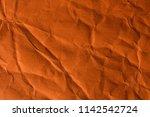 orange crinkle paper background. | Shutterstock . vector #1142542724