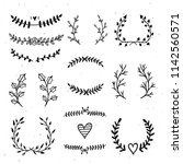 hand drawn wreaths and laurels... | Shutterstock .eps vector #1142560571