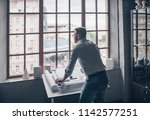working mature man in the studio | Shutterstock . vector #1142577251
