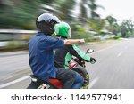 rear view of passenger... | Shutterstock . vector #1142577941