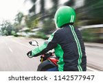 rear view of motorcycle taxi... | Shutterstock . vector #1142577947