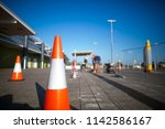 red and white witches hat cone... | Shutterstock . vector #1142586167