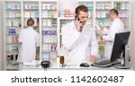 pharmacist man talking on... | Shutterstock . vector #1142602487