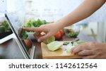 asian woman use finger slide on ...   Shutterstock . vector #1142612564