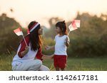 beautiful young mother with her ...   Shutterstock . vector #1142617181
