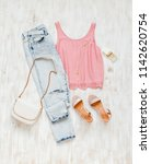 pink top  blue jeans  small...   Shutterstock . vector #1142620754