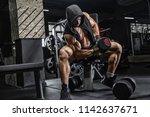 male weightlifter  training in... | Shutterstock . vector #1142637671