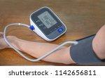 man check blood pressure... | Shutterstock . vector #1142656811