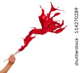Red paints splashing out of brush. Isolated on white background - stock photo