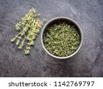 dried thyme in metal bowl on... | Shutterstock . vector #1142769797