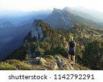 athlete trailrunning in the... | Shutterstock . vector #1142792291