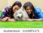 two beautiful friends having... | Shutterstock . vector #1142891171