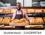selective focus of african... | Shutterstock . vector #1142898764