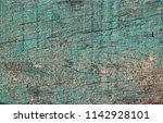 closed up of flaking color wood ... | Shutterstock . vector #1142928101