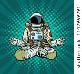 yoga astronaut lotus pose.... | Shutterstock .eps vector #1142969291