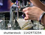 close up of barman hand at beer ... | Shutterstock . vector #1142973254
