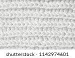 knitting from woolen threads... | Shutterstock . vector #1142974601