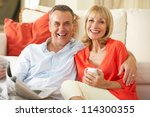 senior couple relaxing on sofa... | Shutterstock . vector #114300355