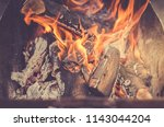 burning firewood in barbecue... | Shutterstock . vector #1143044204