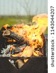 burning brazier with firewood... | Shutterstock . vector #1143044207