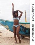 attractive ebony bikini model... | Shutterstock . vector #1143050441