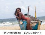 attractive ebony bikini model... | Shutterstock . vector #1143050444