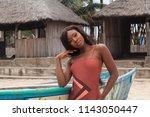 attractive ebony bikini model... | Shutterstock . vector #1143050447