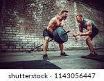 two muscular athletes training  ... | Shutterstock . vector #1143056447