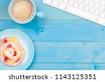 coffee cup with a cake and a... | Shutterstock . vector #1143125351