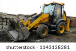 yellow wheeled tractor... | Shutterstock . vector #1143138281