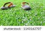 sandals on grass.concept of... | Shutterstock . vector #1143162707