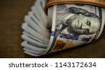 macro shot of a 100 dollar.... | Shutterstock . vector #1143172634