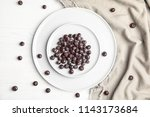 plates with fresh acai berries... | Shutterstock . vector #1143173684