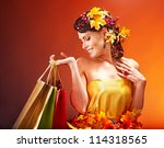 Girl with  autumn hairstyle and shopping bag. - stock photo