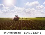 tractor on soy field spraying | Shutterstock . vector #1143213341