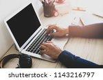 blurred men are using computers ... | Shutterstock . vector #1143216797