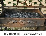 decorated forged steel grill... | Shutterstock . vector #1143219434