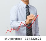 man hand drawing a growth graph - stock photo