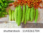 bitter gourds  tomatoes  and... | Shutterstock . vector #1143261704