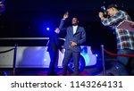 ethnic celebrity man walking... | Shutterstock . vector #1143264131