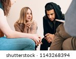 group of teenagers sitting... | Shutterstock . vector #1143268394