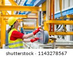factory worker pressing a red... | Shutterstock . vector #1143278567
