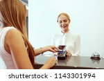 woman checking in at hotel... | Shutterstock . vector #1143301994
