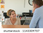 agency receptionist helping a... | Shutterstock . vector #1143309707