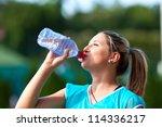 closeup of a young sportswoman... | Shutterstock . vector #114336217