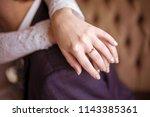 wedding ring on the bride's... | Shutterstock . vector #1143385361