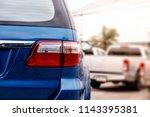 back light of blue suv car ... | Shutterstock . vector #1143395381